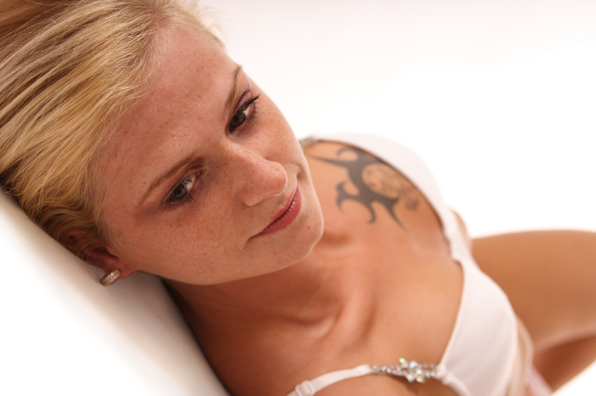 Woman_with_tattoo_on_chest_iStock_000000741231_Small
