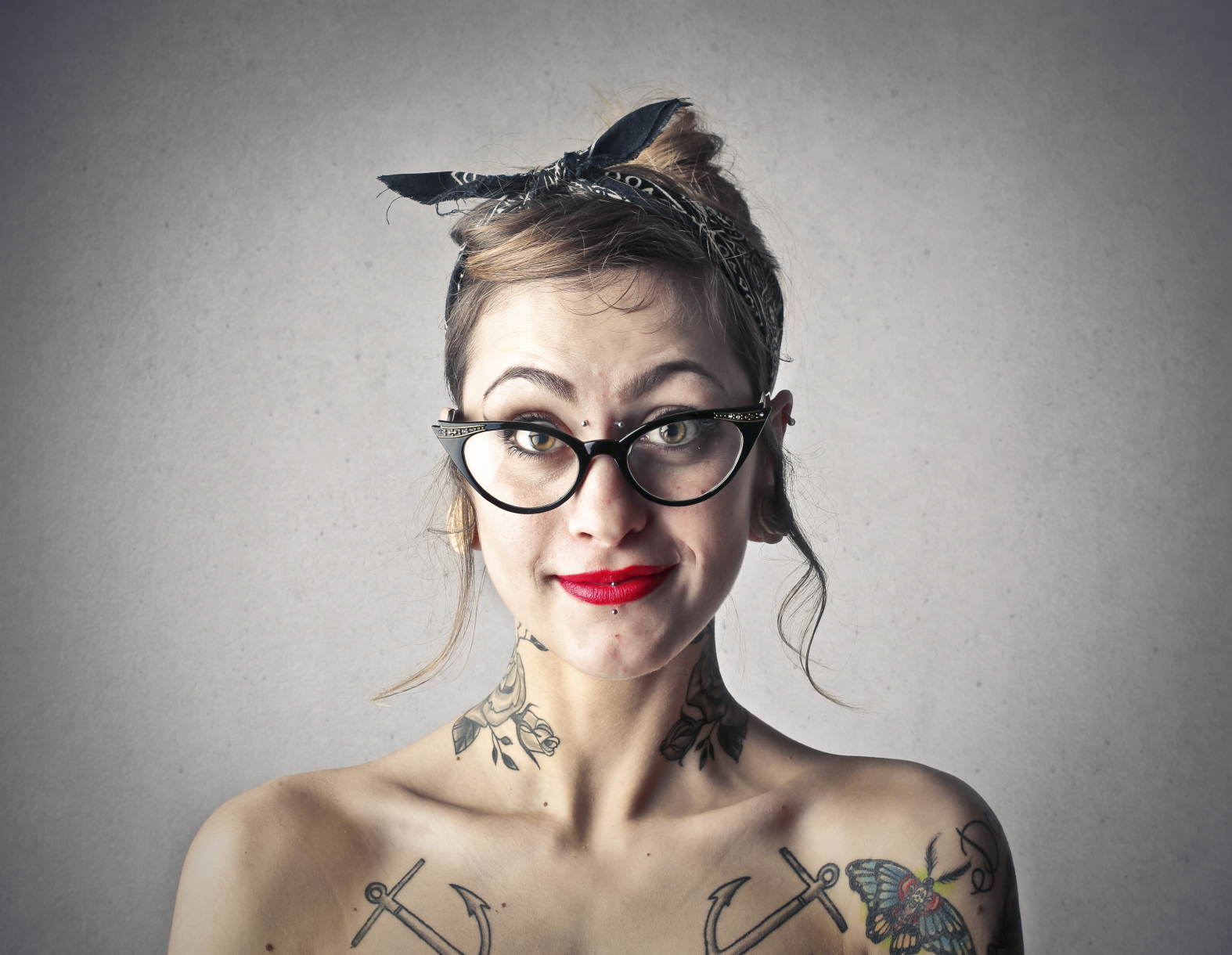 lady_with_tattoos_iStock_000053684088_Medium