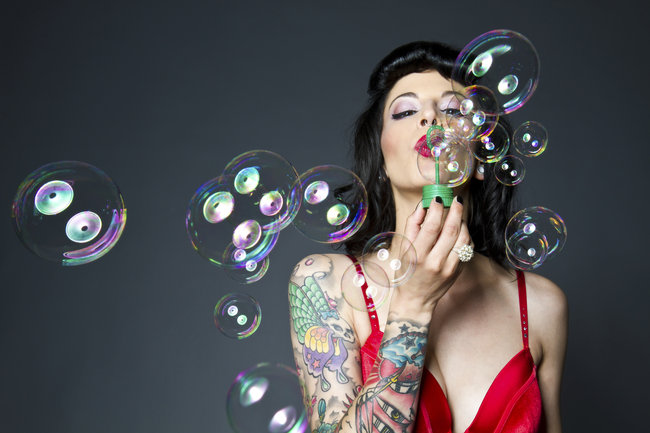 woman_with_tattoo_blowing_bubbles